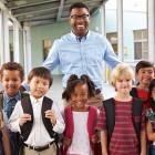 Teacher-with-kids-in-corridor