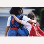 School Reopening - friends with backpacks going-to school