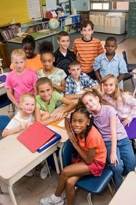 children in classroom looking up from desks