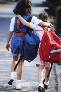 Friends with backpacks going to school