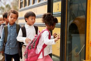 children-getting-on-school-bus